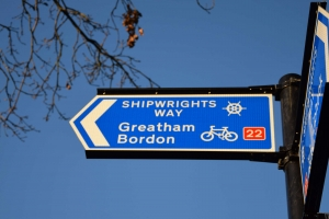 sign showing direction to Greatham Bordon